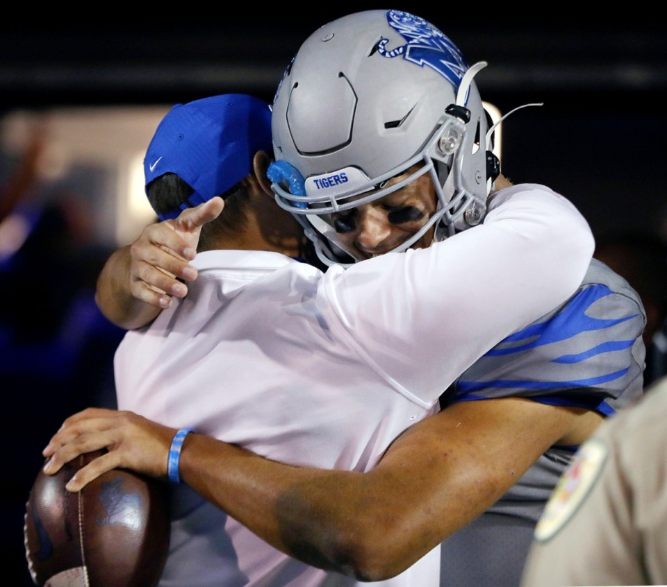<strong>University of Memphis quarterback Brady White (3) gives head coach Ryan Silverfield a hug while holding the game ball after an Oct. 17, 2020 game against University of Central Florida at Liberty Bowl Memorial Stadium.</strong> (Patrick Lantrip/Daily Memphian)
