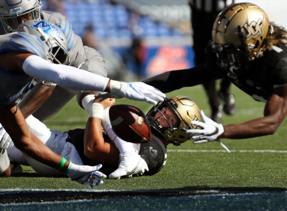 <strong>University of Central Florida quarterback Dillon Gabriel (11) watches a teammate fight for a loose ball during an Oct. 17, 2020 game against the University of Memphis at Liberty Bowl Memorial Stadium.</strong> (Patrick Lantrip/Daily Memphian)