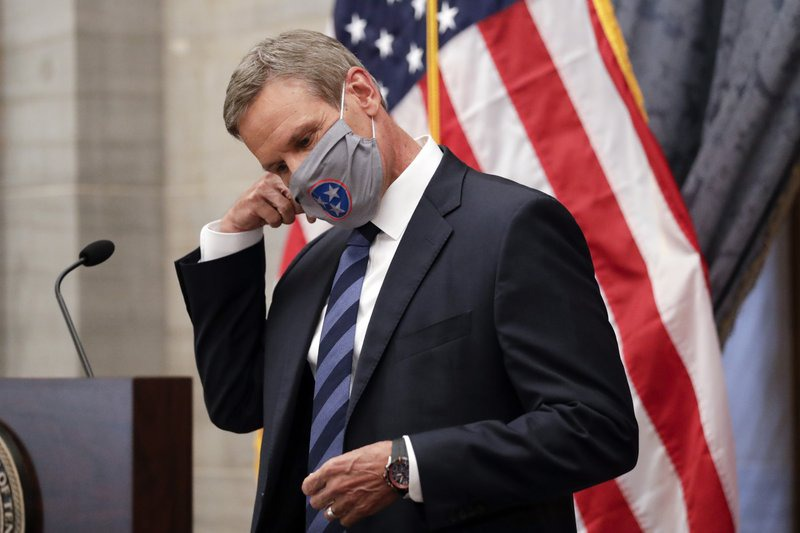 <strong>Tennessee Gov. Bill Lee (in a file photo) removes his mask as he begins a news conference in Nashville</strong>. (Mark Humphrey/AP)