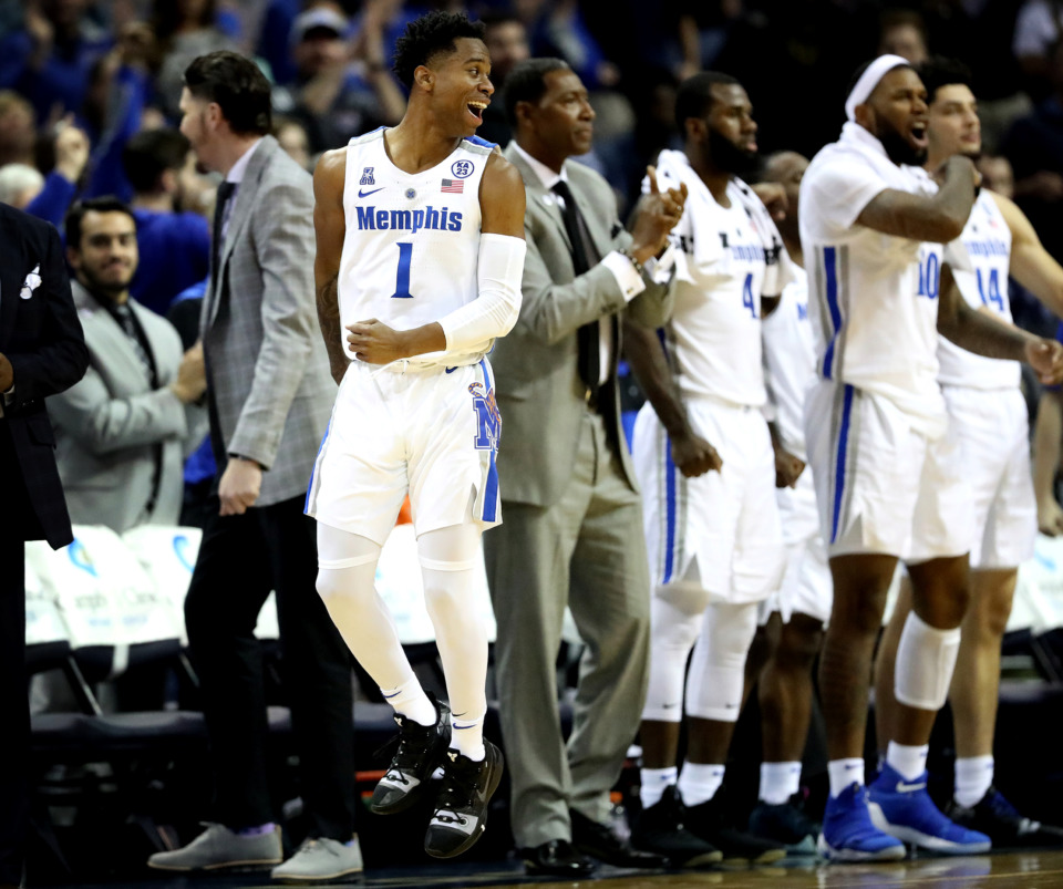 <strong>University of Memphis guard Tyler Harris (1) celebrates after a teammate dunks a basket in a game against the Little Rock Trojans on Wednesday, Dec. 19, 2018, at FedExForum in Memphis.&nbsp;</strong>(Houston Cofield/Daily Memphian)