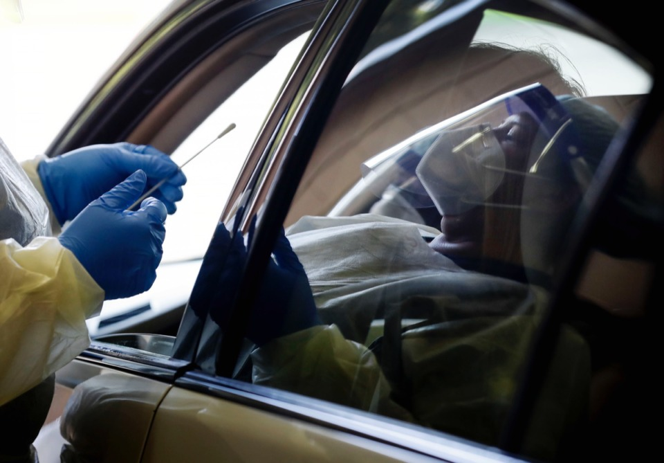 <strong>Christ Community Health Services staff members collect nasal swabs during at a drive-thru coronavirus testing site on Wednesday, Oct. 20, 2020 on Lamar Ave</strong>. (Mark Weber/The Daily Memphian)