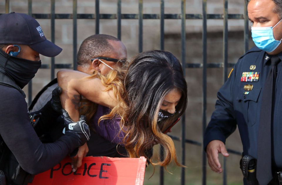 <strong>A protester gets hauled away by police at a protest over an appearance by Attorney General William Barr at the Memphis Police Department Ridgeway Station Oct. 21, 2020.</strong> (Patrick Lantrip/Daily Memphian)