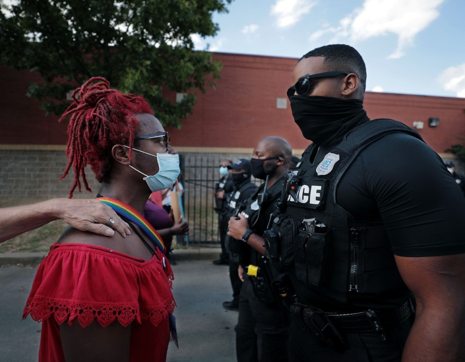 <strong>A protester gets pulled back from a standoff with Memphis Police officers during a protest over an appearance by Attorney General William Barr at the Memphis Police Department Ridgeway Station Oct. 21, 2020.</strong> (Patrick Lantrip/Daily Memphian)