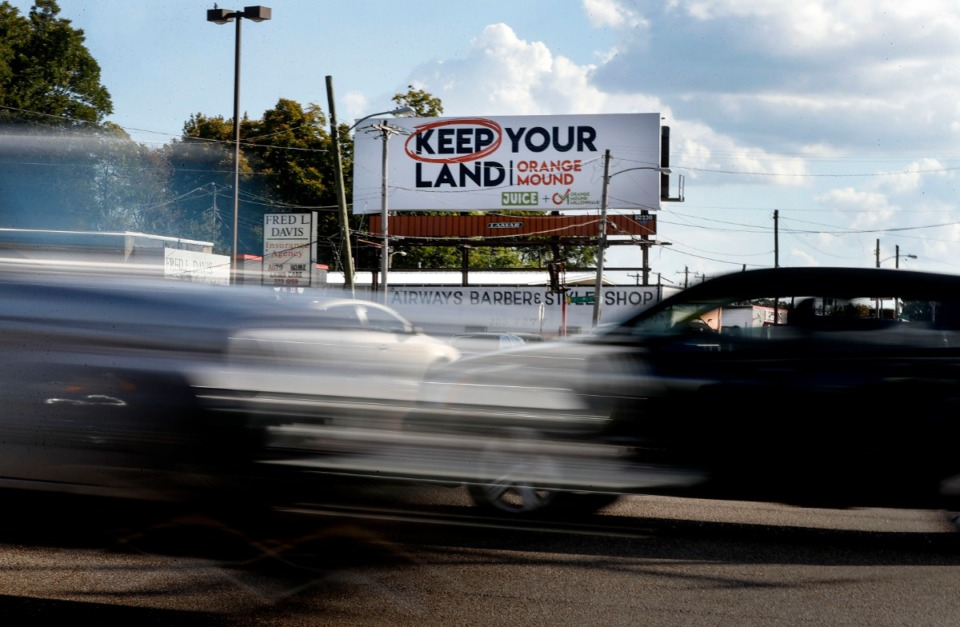 <strong>The Orange Mound Millennials, in collaboration with Juice Orange Mound, erected a billboard that says &ldquo;Keep Your Land Orange Mound&rdquo; at Park and Airways.</strong> (Mark Weber/The Daily Memphian)
