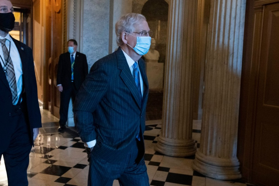 <strong>Senate Majority Leader Mitch McConnell, R-Ky., right, steps out of the Senate chamber on Capitol Hill, in Washington, Thursday, Oct. 22, 2020.</strong> (Jose Luis Magana/AP)