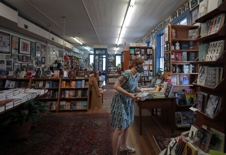 <strong>Jude Burke-Lewis searches for a book at Square Books in Oxford, Mississippi, Oct. 20, 2020.</strong> (Patrick Lantrip/Daily Memphian)