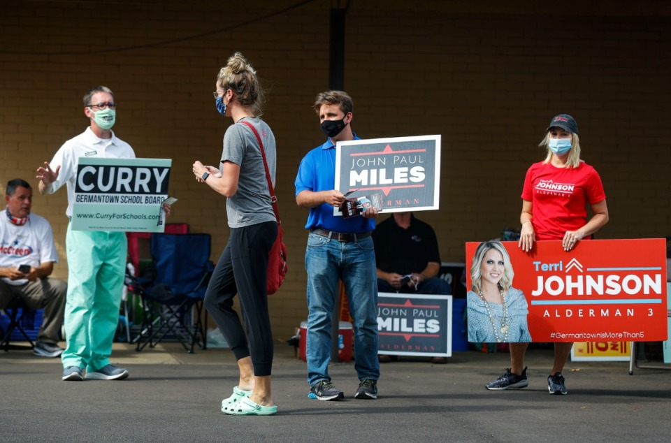 <strong>Germantown candidates, Brian Curry (left), who&rsquo;s running for a school board position, John Paul Miles (middle) and Terri Johnson (right), both running for alderman positions, campaign outside New Bethel Missionary Baptist Church in Germantown on Friday, Oct. 23, 2020.</strong> (Mark Weber/The Daily Memphian)