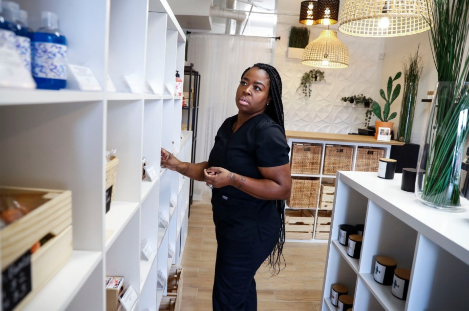 <strong>Eukivi Products owner Takila Phillips looks over inventory on Friday, Oct. 23, 2020, in Whitehaven.</strong> (Mark Weber/The Daily Memphian)