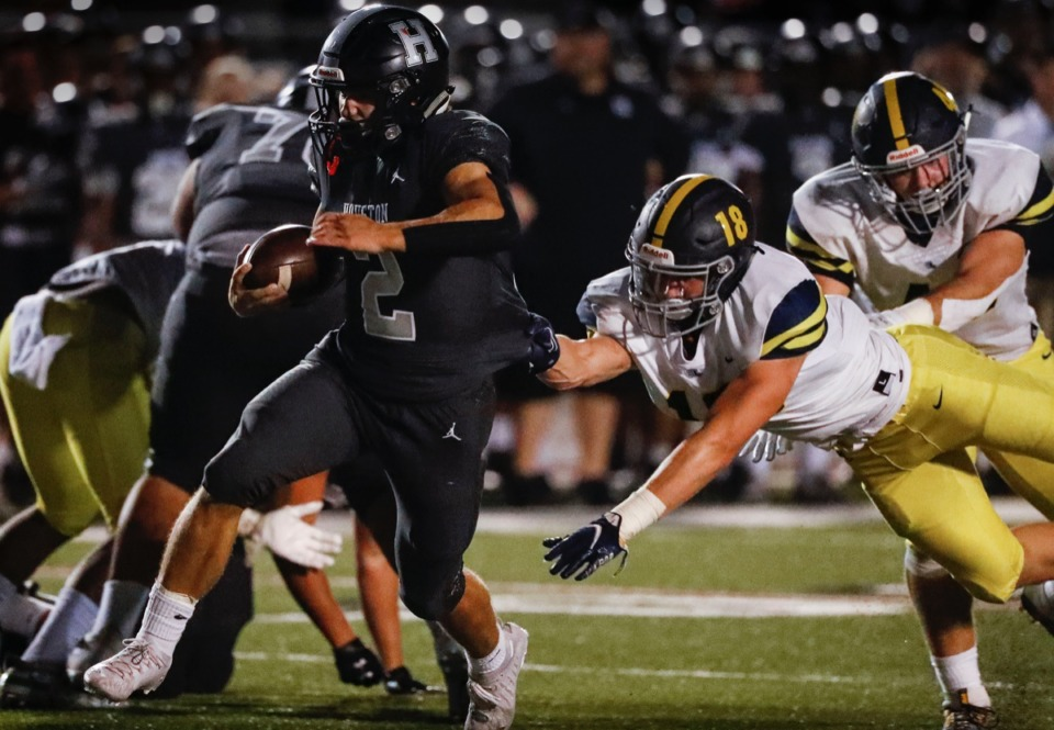 <strong>Houston running back Ben Stegall (left) scrambles past Lausanne defender Ben Bolton (right) for a touchdown on Friday, Oct. 23, 2020.</strong> (Mark Weber/The Daily Memphian)