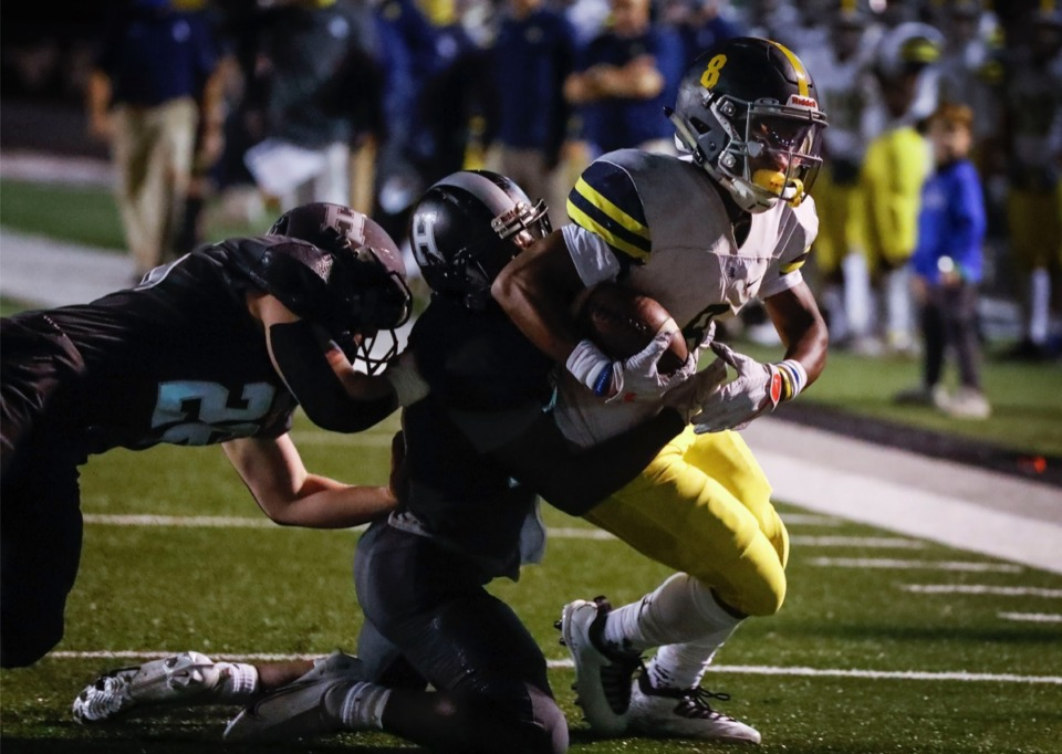 <strong>Lausanne running back Craig Cunningham (right) drags several Houston defenders into the end zone for a touchdown on Friday, Oct. 23, 2020.</strong> (Mark Weber/The Daily Memphian)