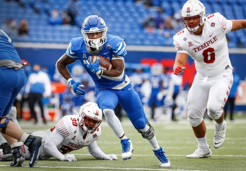 <strong>Memphis running back Rodrigues Clark (left) runs past the Temple defense for a touchdown during action on Saturday, Oct. 24, 2020 at Liberty Bowl Memorial Stadium.</strong> (Mark Weber/The Daily Memphian)