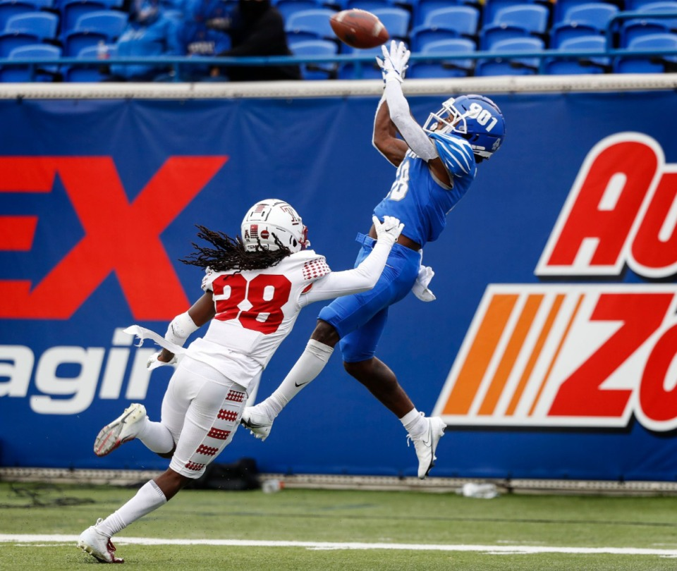 <strong>Memphis receiver Tahj Washington (right) hauls in a touchdown catch against Temple defender Aaron Adu (left) during action on Saturday, Oct. 24, 2020 at Liberty Bowl Memorial Stadium.</strong> (Mark Weber/The Daily Memphian)