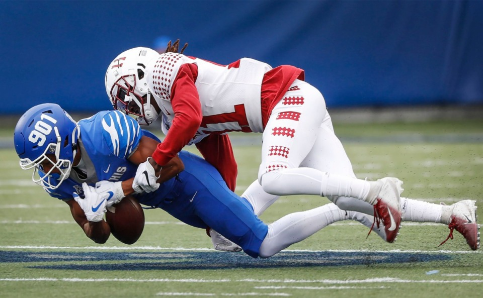 <strong>Memphis receiver Calvin Austin III (left) fumbles the ball after being hit by Temple defender Linwood Crump (right) during action on Saturday, Oct. 24, 2020 at Liberty Bowl Memorial Stadium.</strong> (Mark Weber/The Daily Memphian)