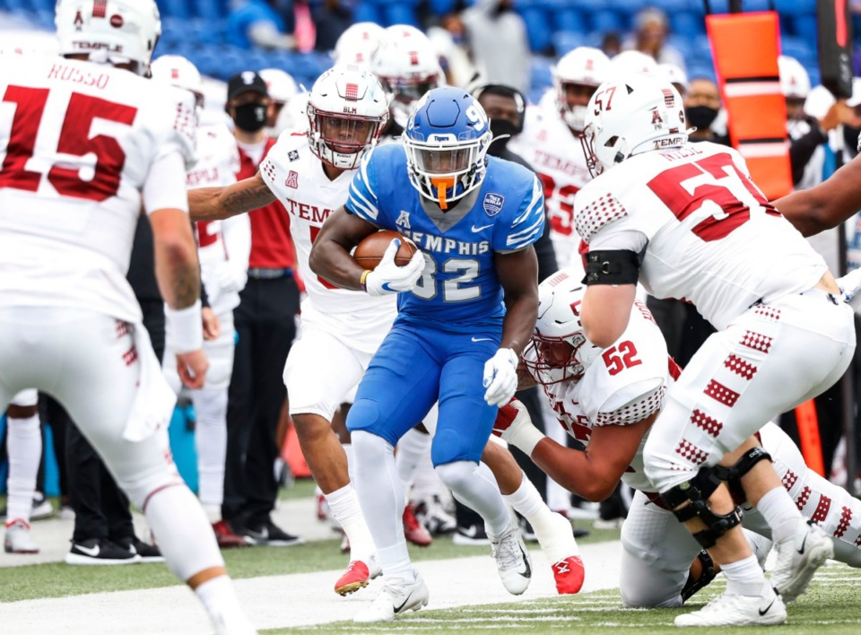 <strong>Memphis defender Jacobi Francis (middle) returns an interception against the Temple defense during action on Saturday, Oct. 24, 2020 at Liberty Bowl Memorial Stadium.</strong> (Mark Weber/The Daily Memphian)