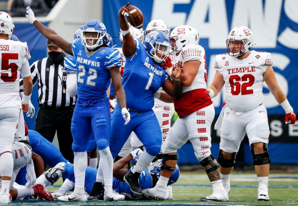 <strong>Memphis defenders Tyrez Lindsey (22) and O'Bryan Goodson (1) celebrate a fumble recovery against the Temple offense during action on Saturday, Oct. 24, 2020 at Liberty Bowl Memorial Stadium.</strong> (Mark Weber/The Daily Memphian)
