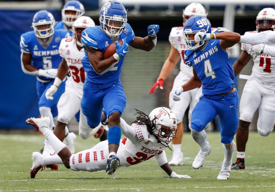 <strong>Memphis running back Rodrigues Clark (left) runs past Temple defender Aaron Adu (bottom) during action on Saturday, Oct. 24, 2020 at Liberty Bowl Memorial Stadium.</strong> (Mark Weber/The Daily Memphian)