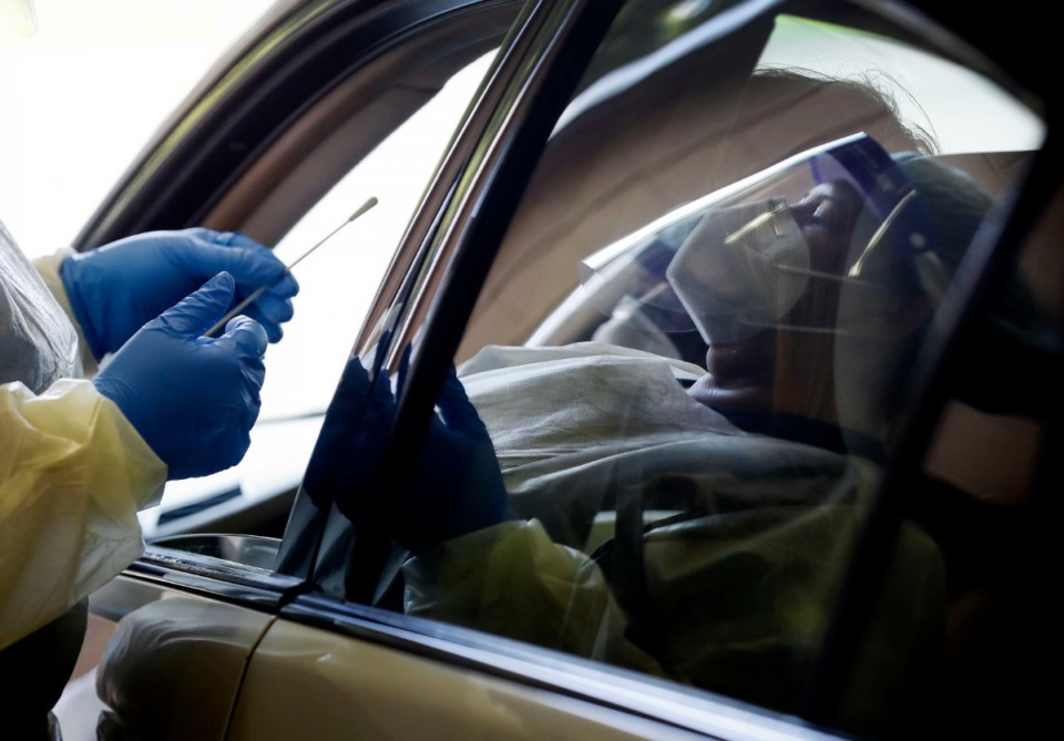 <strong>Christ Community Health Services staff members collect nasal swabs during at a drive-thru coronavirus testing site on Wednesday, October 20, 2020 on Lamar Ave.</strong> (Mark Weber/The Daily Memphian)