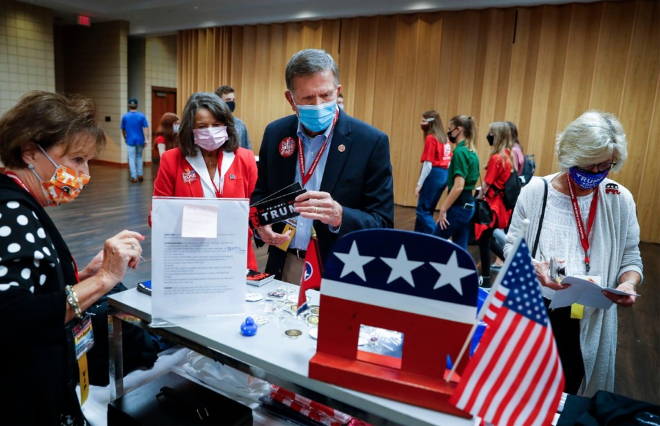 <strong>Senator Paul Rose (middle) buys several President Donald Trump bumper stickers during the Shelby County Republican Party annual Lincoln Day Gala on Friday, Oct. 23, 2020 in Germantown.</strong> (Mark Weber/The Daily Memphian)