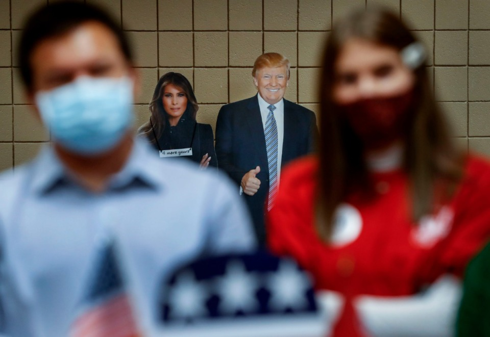 <strong>Life-size photos of President Donald Trump and First Lady Melania Trump greet visitors at the Shelby County Republican Party annual Lincoln Day Gala on Friday, Oct. 23, 2020 in Germantown.</strong> (Mark Weber/The Daily Memphian)