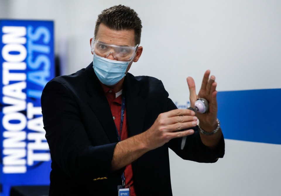 <strong>MicroPort Orthopedics Vice President David Sharp demonstrates one of the medical device company&rsquo;s manufactured hip replacement parts on Monday, Oct. 19, 2020 in Arlington.</strong> (Mark Weber/The Daily Memphian)