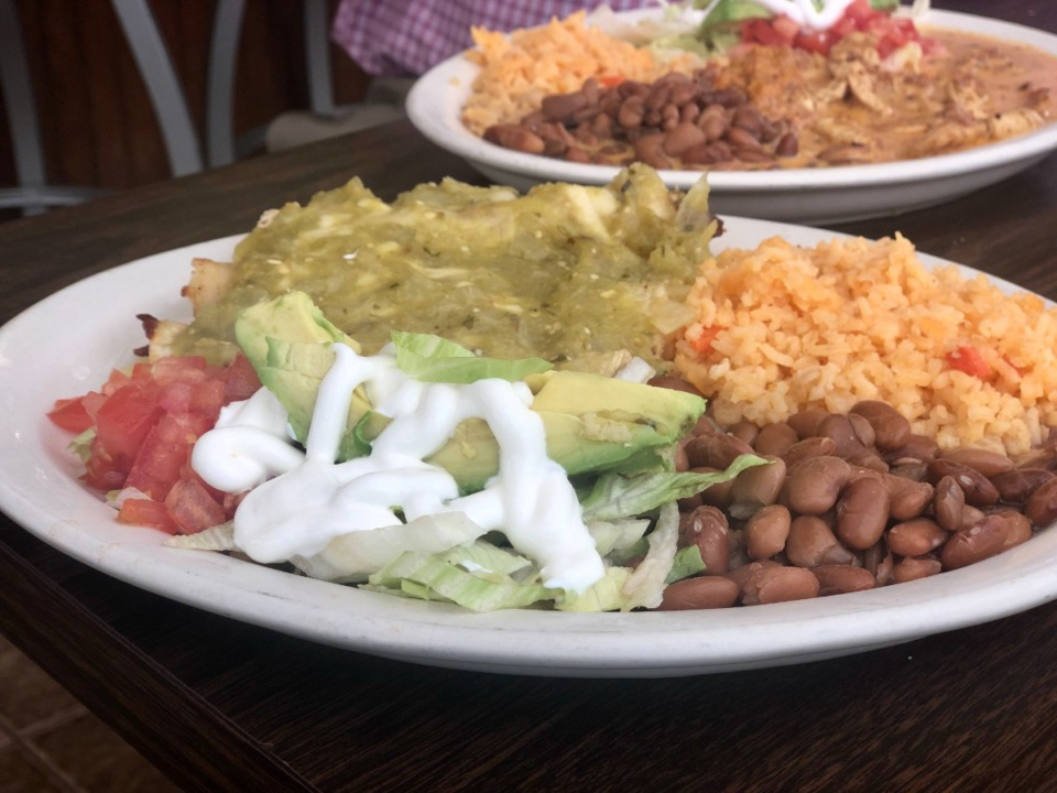 <strong>Enchiladas verdes is served at La Unica, which recently opened in an old Wendy&rsquo;s on Summer Avenue.</strong> (Jennifer Biggs/Daily Memphian)