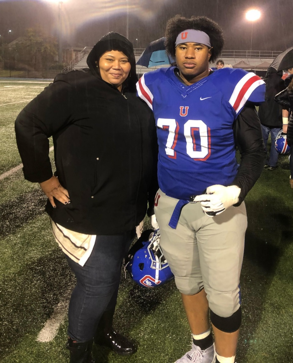<strong>&ldquo;I want to give back to the communities in Memphis where kids don&rsquo;t really have the opportunities that have been presented to me,&rdquo; said Devin Malone, seen here with his mother, LeAndrea Taylor, at an MUS game in 2019. Malone has committed to play at Cornell and he is spending this year at Phillips Exeter Academy in New Hampshire.</strong> (Coutesy Devin Malone)