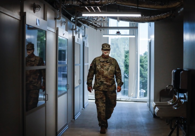 <strong>Lt. Col. Nathan Molica with the U.S. Army Corps of Engineers Memphis Division leads a tour of an emergency hospital in the former Commercial Appeal building on Monday, May 18, 2020.</strong> (Mark Weber/Daily Memphian)