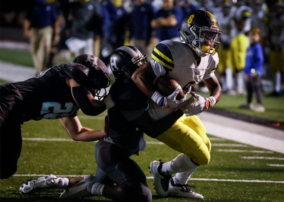 <strong>Lausanne running back Craig Cunningham (right) drags several Houston defenders into the end zone for a touchdown during action on Friday, Oct. 23, 2020.</strong> (Mark Weber/The Daily Memphian)
