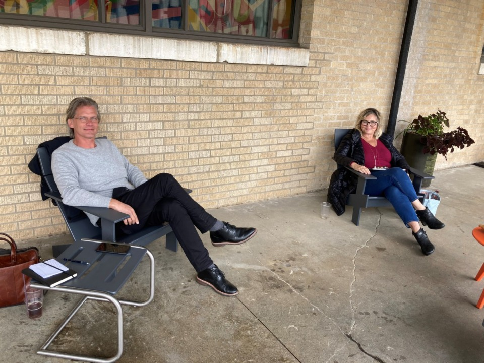 <strong>Eric Barnes, left, and Jennifer Biggs sit outside Crosstown Concourse, interviewing each other for their respective WYXR/Daily Memphian podcasts.</strong> (Natalie Van Gundy/Daily Memphian)
