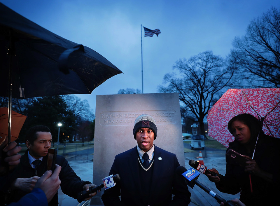 <strong>Van Turner (center) director and president of Memphis Greenspace, the nonprofit that bought two Downtown parks and removed the Confederate statues, talks to the media in Health Sciences Park on Dec. 20, 2018, the one-year anniversary of the monuments' removal.</strong> (Jim Weber/Daily Memphian)