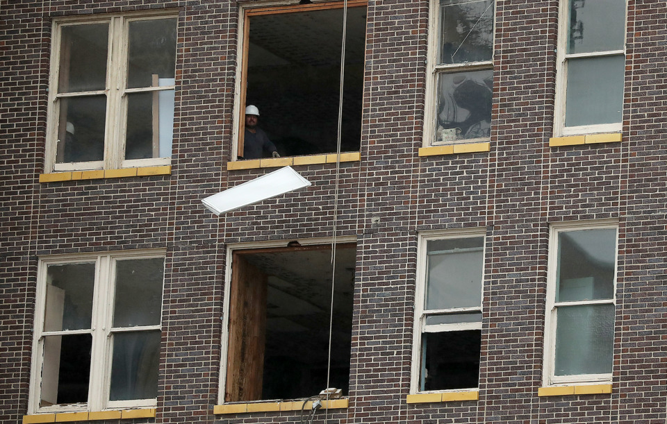 <strong>Interior-demolition workers have removed some large windows to make openings through which they toss old furnishings and debris.&nbsp;</strong>(Patrick Lantrip/Daily Memphian)&nbsp;