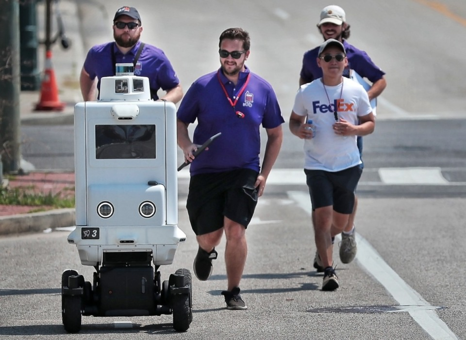 <strong>The FedEx Innovation Showcase pulled together key officials at FedEx Corp. and operating units FedEx Express, FedEx Ground and FedEx Office to talk about innovations including Roxo the SameDay Bot (shown in September 2019 during&nbsp;a test run near FedExForum).</strong> (Jim Weber/Daily Memphian file)