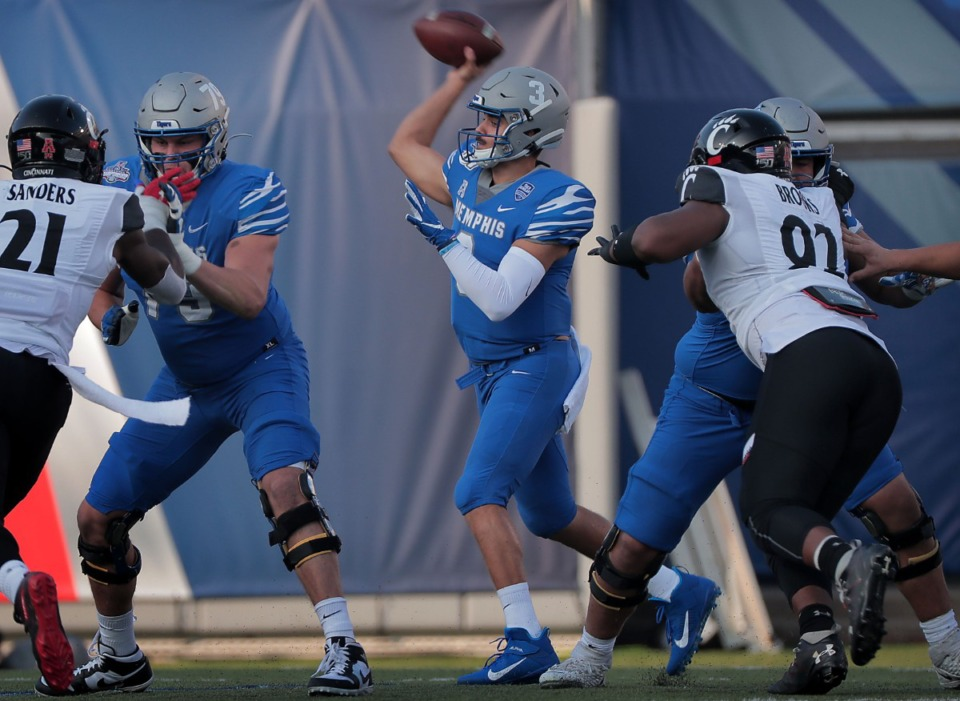 <strong>University of Memphis quarterback Brady White passes under pressure in the first half of the Tiger's AAC Championship game on Dec. 7, 2019, against the Bearcats at the Liberty Bowl Memorial Stadium.</strong> (Jim Weber/Daily Memphian file)