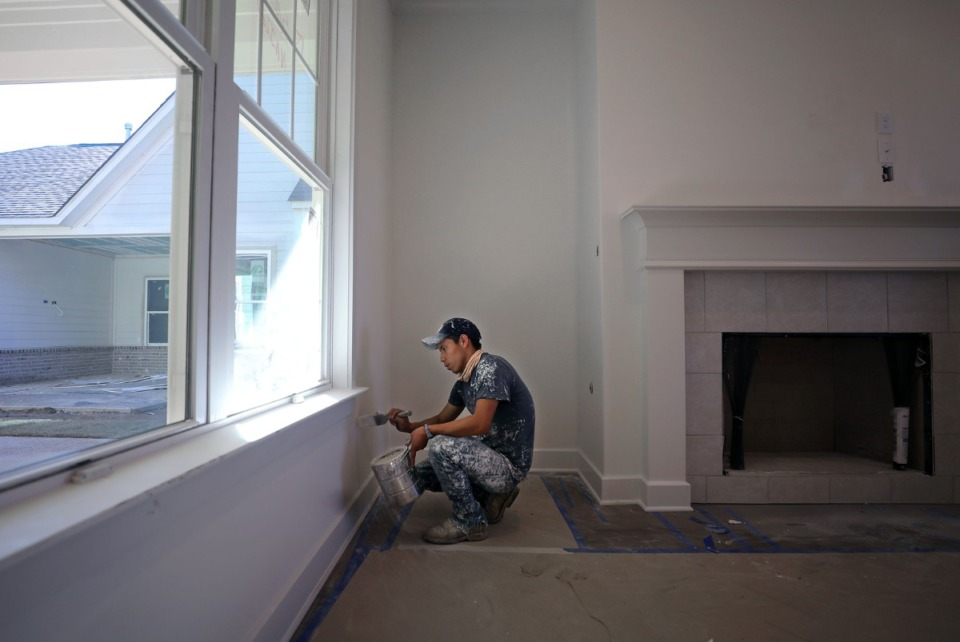 <strong>Romeo Domingo paints an interior wall of a new house that's under construction in Arlington Oct. 30, 2020.</strong> (Patrick Lantrip/Daily Memphian)
