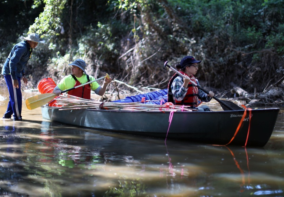 <strong>University of Memphis Center for Applied Earth Science and Engineering Research&nbsp;students embark via canoe on the Wolf River on July 26, 2019, to detect breaches in the Memphis aquifer.</strong>&nbsp;(Patrick Lantrip/Daily Memphian file)&nbsp;