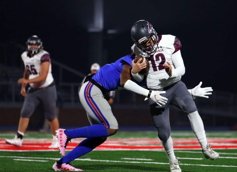 <strong>Collierville High School quarterback Ethan Pettigrew (12) gets tackled during an Oct. 30, 2020, game at Bartlett.</strong> (Patrick Lantrip/Daily Memphian)