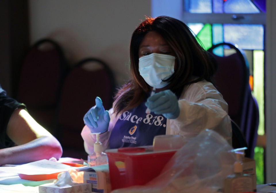 <strong>A Shelby County Health Department worker gets a flu shot ready during a COVID-19 and flu awareness event Oct. 17, 2020 at Iglesia Methodista Unida el Redentor at 2969 S. Mendenhall Road in Southeast Memphis.</strong> (Patrick Lantrip/Daily Memphian)