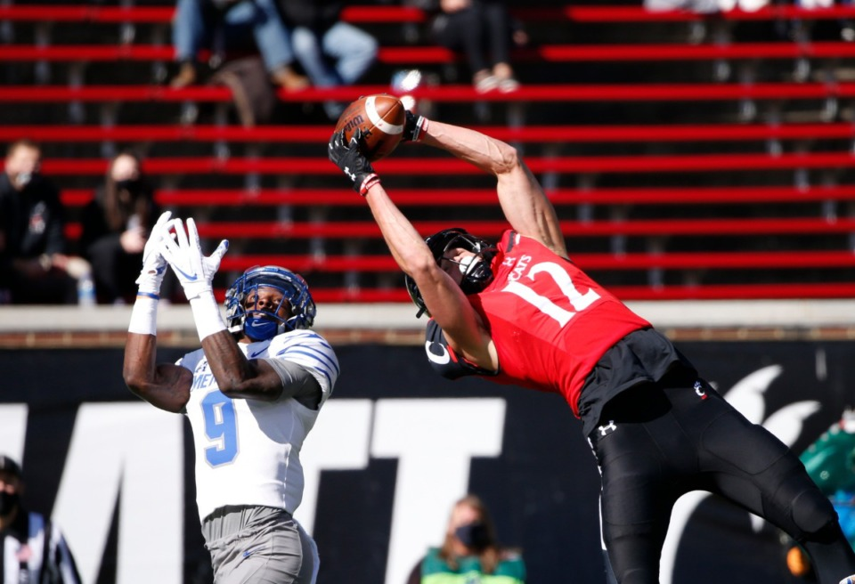<strong>Cincinnati wide receiver Alec Pierce (12) catches a touchdown pass in front of Memphis defensive back John Broussard Jr. (9) during the first half of an NCAA college football game Saturday, Oct. 31, 2020, in Cincinnati.</strong> (Gary Landers/AP)
