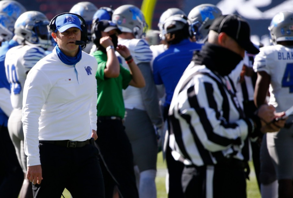 <strong>Memphis head coach Ryan Silverfield, left, talks to a referee during the first half of an NCAA college football game against Cincinnati Saturday, Oct. 31, 2020, in Cincinnati.</strong> (Gary Landers/AP)