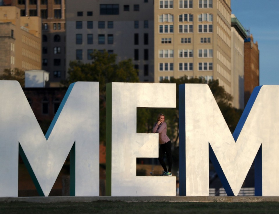 <strong>Despite Mud Island&rsquo;s neglected state, the Memphis sign is a popular spot for photos.&nbsp;Kaitlin Higginbotham posed Saturday, Oct. 31, 2020 while her friend Katie Richmer (not shown) snapped a picture.</strong> (Patrick Lantrip/Daily Memphian)