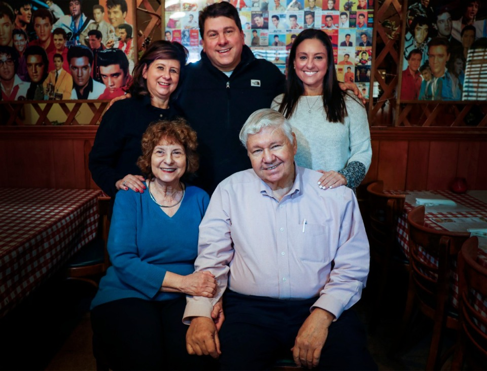 <strong>Coletta&rsquo;s Italian Restaurant owners Diane and Jerry Coletta (front) and their children (back, from left) Lisa Coletta, Stephen Coletta and Kristina Holland, sit in the South Parkway location dining room on Monday, Nov. 2, 2020.</strong> (Mark Weber/The Daily Memphian)