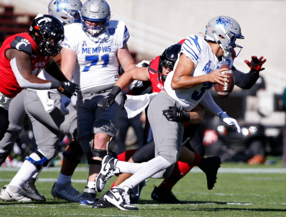 <strong>Memphis quarterback Brady White (3) scrambles from the pocket as he is pursued by Cincinnati linebacker Wilson Huber, rear, during the second half of an NCAA college football game Saturday, Oct. 31, 2020, in Cincinnati. Cincinnati won 49-10.</strong> (Photo by Gary Landers)