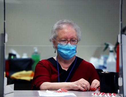 "<strong>Sandra Brigham peels off ""I Voted"" stickers for voters at Bartlett Baptist Church Nov. 3, 2020.</strong> (Patrick Lantrip/Daily Memphian)"