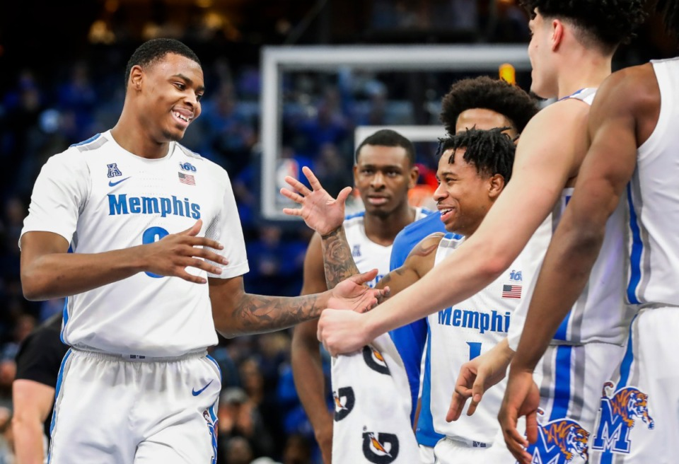 <strong>Memphis forward D.J. Jeffries (left) celebrates with his teammates during a break in action against Cincinnati on Jan. 16, 2020, at FedExForum. Jeffries is a candidate for the Julius Erving Award, given each year to the best small forward in college basketball.</strong>&nbsp;(Mark Weber/Daily Memphian file)
