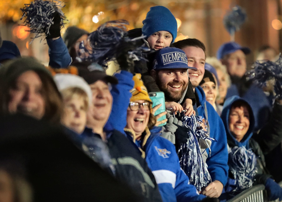 <strong>John Sumerel and his son Walker, 4, chant for the Tigers as University of Memphis fans gather in the Uptown area of Birmingham on Dec. 21, 2018, for a Birmingham Bowl pep rally in advance of the Tigers' bowl matchup against Wake Forest Saturday.</strong> (Jim Weber/Daily Memphian)