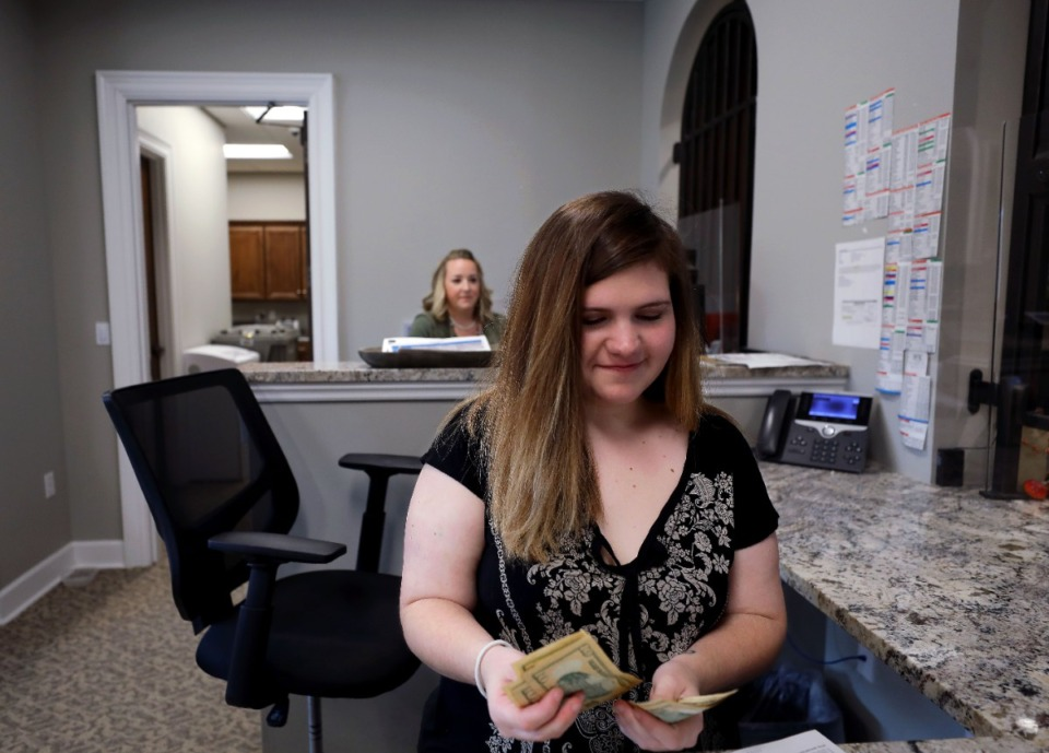 <strong>Rylee Griffin counts a deposit at the Bank of Collierville, which is a branch of the Bank of Fayette County, Nov. 5, 2020.</strong> (Patrick Lantrip/Daily Memphian)