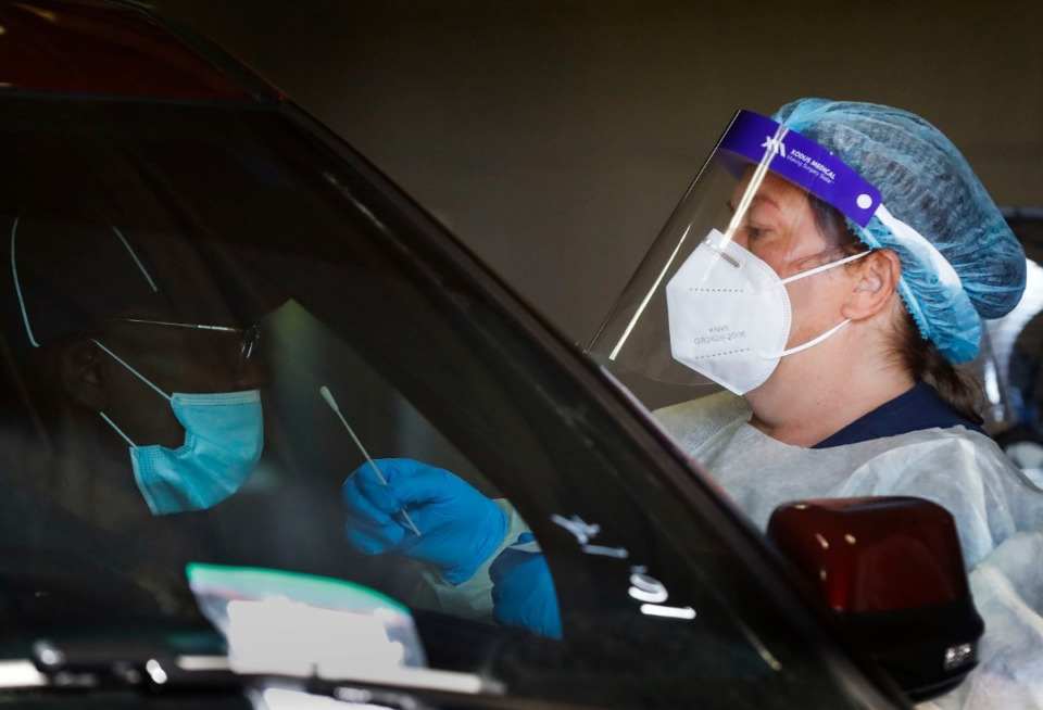 <strong>Christ Community Health Services staff members collect nasal swabs during drive-thru coronavirus testing Wednesday, Oct. 20, 2020 on Lamar Avenue.</strong> (Mark Weber/The Daily Memphian)