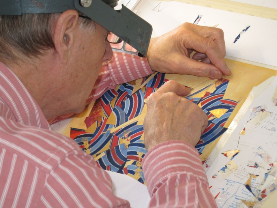 <strong>The calligrapher and artist Donald Jackson in&nbsp;his studio in Wales.</strong>&nbsp;(Image courtesy of Donald Jackson&rsquo;s Scriptorium, Wales, UK)
