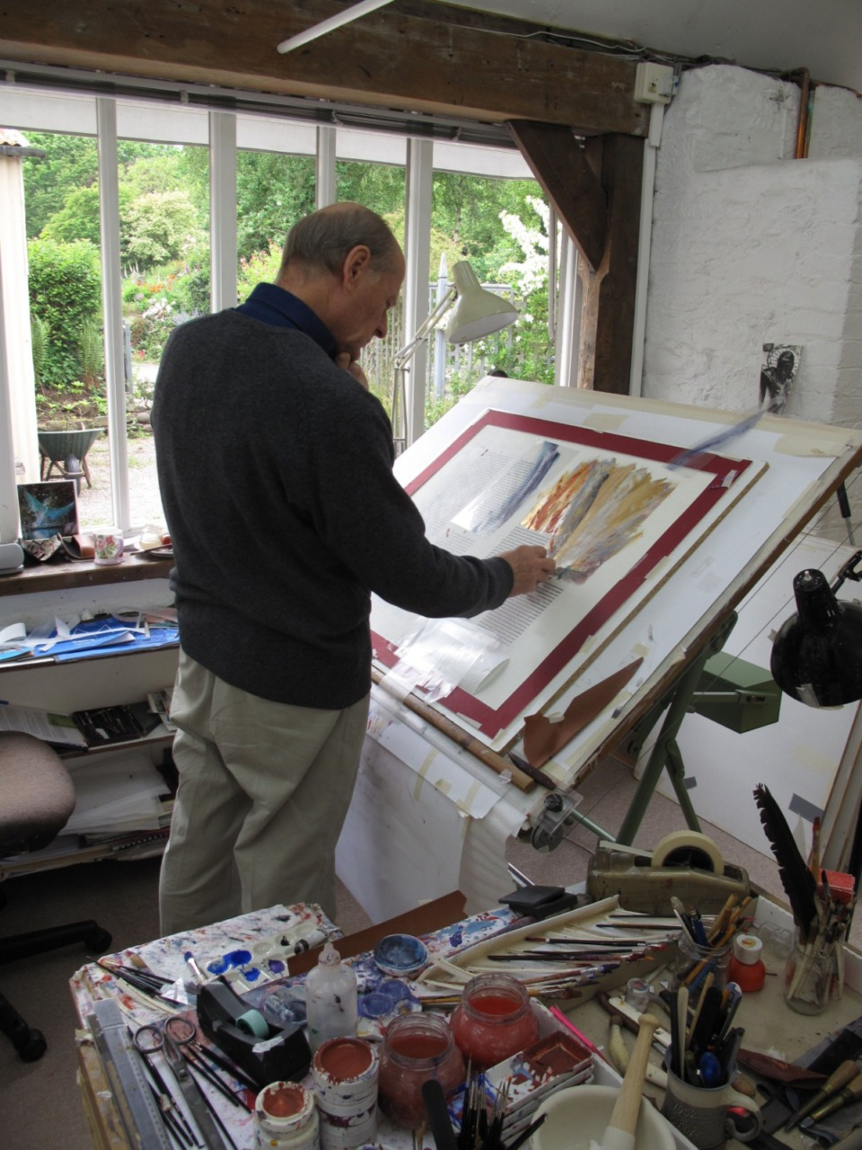 <strong>Donald Jackson works in his studio.&nbsp; In 1995, Jackson proposed that Saint John&rsquo;s Abbey mark the millennium with a handwritten, illuminated Bible that would celebrate the Benedictines&rsquo; centuries of devotion to book-making.&nbsp;After three years of fundraising and planning, the project was commissioned.</strong> (Image courtesy of Donald Jackson&rsquo;s Scriptorium, Wales, UK)