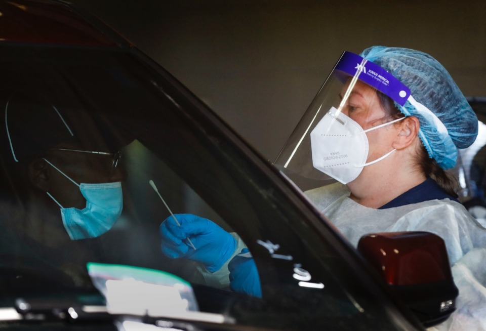 <strong>Christ Community Health Services staff members collect nasal swabs during at a drive-thru coronavirus testing site on Wednesday, Oct. 20, 2020 on Lamar Avenue.</strong> (Mark Weber/The Daily Memphian)